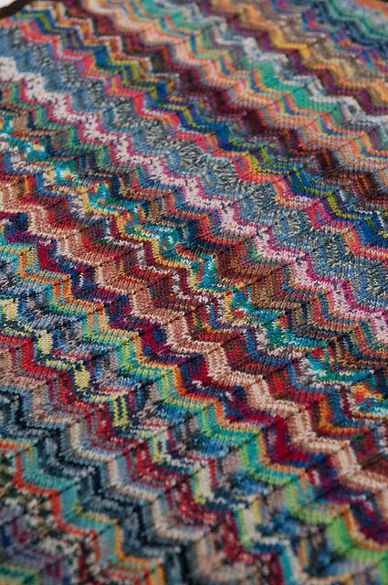 Ravelry: Zig and Zag Sock Yarn pram baby blanket pattern by Debbie Orr
