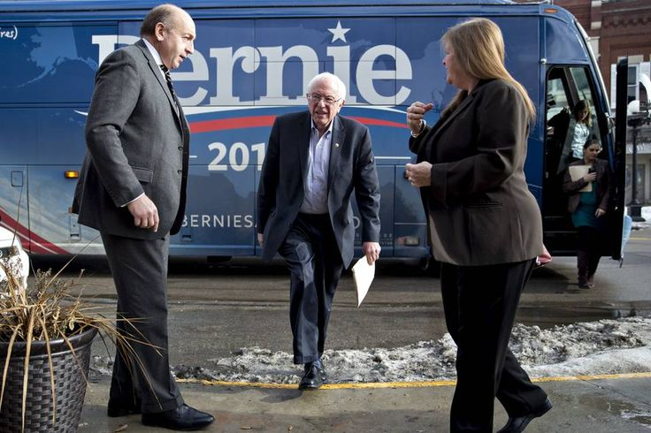 Sen. Bernie Sanders arrives to speak in Waterloo, Iowa, on Sunday. He launched a negative...