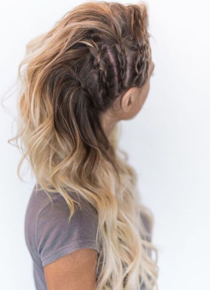 Avante-garde-inspired side braid faux mohawk with curls all falling and pinned to one side over the shoulder.