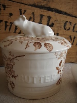 love this cow perched on the lid of a brown transferware butter crock!