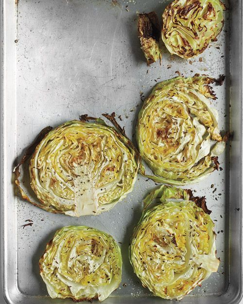 Roasted Cabbage Wedges - 1 Tbs. plus 2 more Tbs. extra-virgin olive oil, 1 medium head green cabbage, cut into 1-inch-thick rounds, coarse salt, ground pepper,1 tsp. caraway or fennel seeds  400 degrees. 40 to 45 minutes.