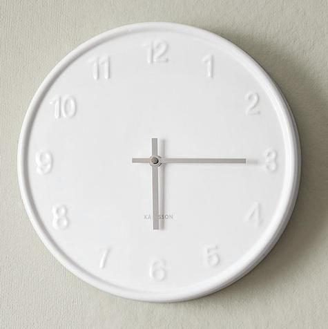 10 Easy Pieces: Simple Kitchen Clocks. Shown here is a white ceramic and steel clock from Karlsson.