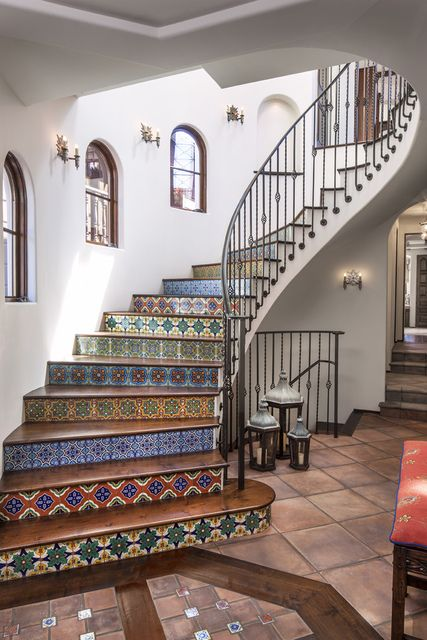 Wow! This is eye-candy! Beautiful encaustic tiles in a variety of patterns and colours! Norman-design-group-portfolio-interiors-mediterranean-staircase