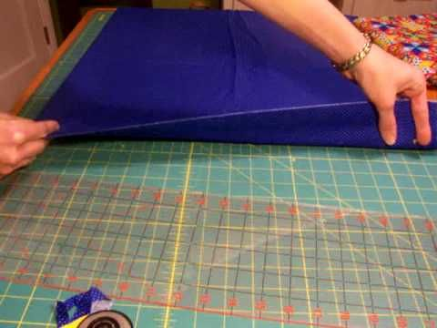 Beginners demonstrate the basic steps of quilting, including rotary cutting, chain piecing, applique, basting, hand quilting, machine quilting, and binding.  1. Rotary Cutting