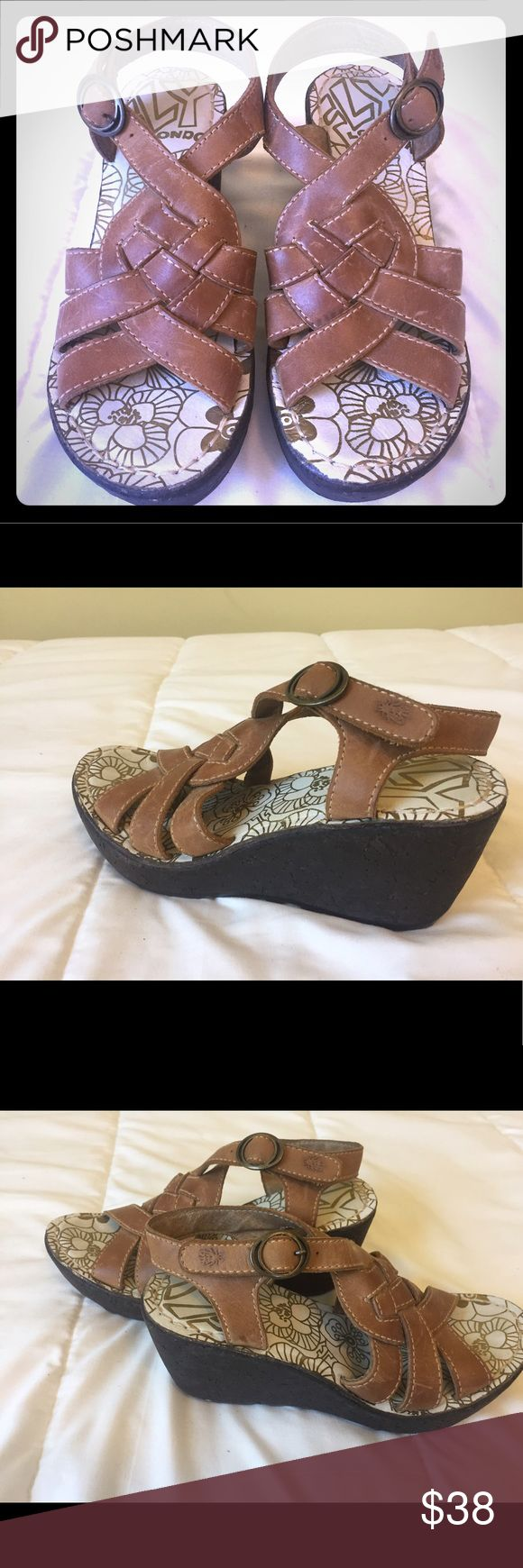 """Fly London Wedge Sandals! Fly London Wedge Sandals with medium brown leather and rubber soles. Fun, summery shoes that are great with skirts and pants. The Wedge heal measures 3"""". Cushioned insole makes them super comfy.  Gently worn. Fly London Shoes Wedges"""