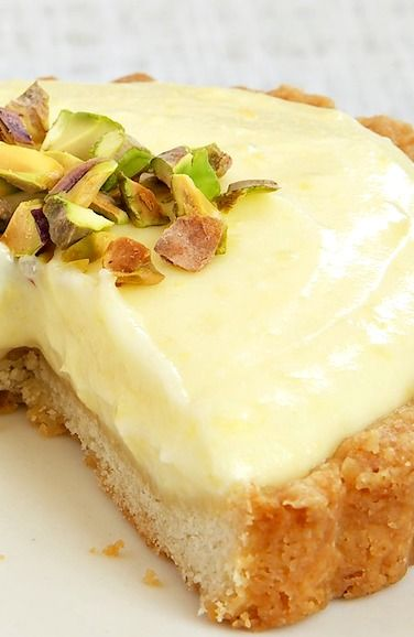 Lemon Cream Tarts Recipe ~ They're tart and sweet and creamy, and the crispy cookie crust is a great complement to all that filling.
