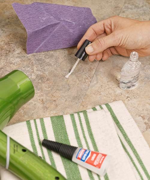 Repair vinyl flooring: Use blow dryer or heat gun to heat area around the gouge. Stretch & smooth material back into place and glue to subfloor with acrylic glue. Weigh it down to dry flat. Layers of nail polish in close color will fill small gaps & seep into and bond to flooring.