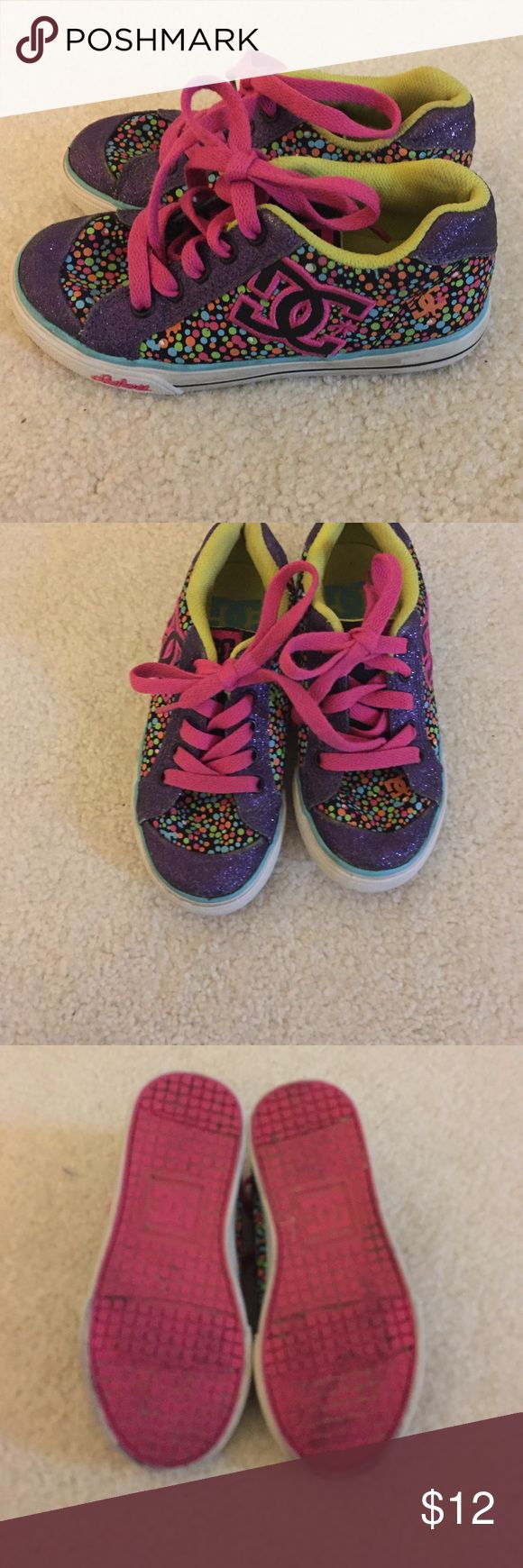 Girls DC Sneakers with Purple Glitter EUC Girls DC Sneakers with purple glitter detail. These were worn sole but outgrown quickly. DC Shoes Sneakers