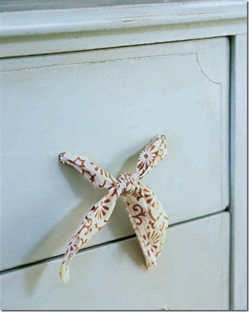 Don't have knobs? Try DIY fabric drawer pulls!       Just drill two holes in the front of your drawer and thread fabric through.       Then tie in knots on the inside to secure in place.       Then tie another knot in the front of the drawer to make a bow.       This would look great for a beachy rustic feel.