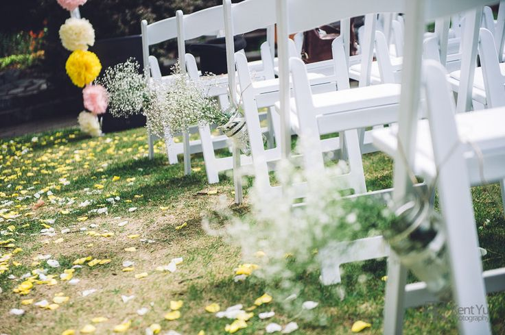 Jars, baby's breath, pom poms and rose petals.  Outdoor ceremony styled by Vintage & Pretty.