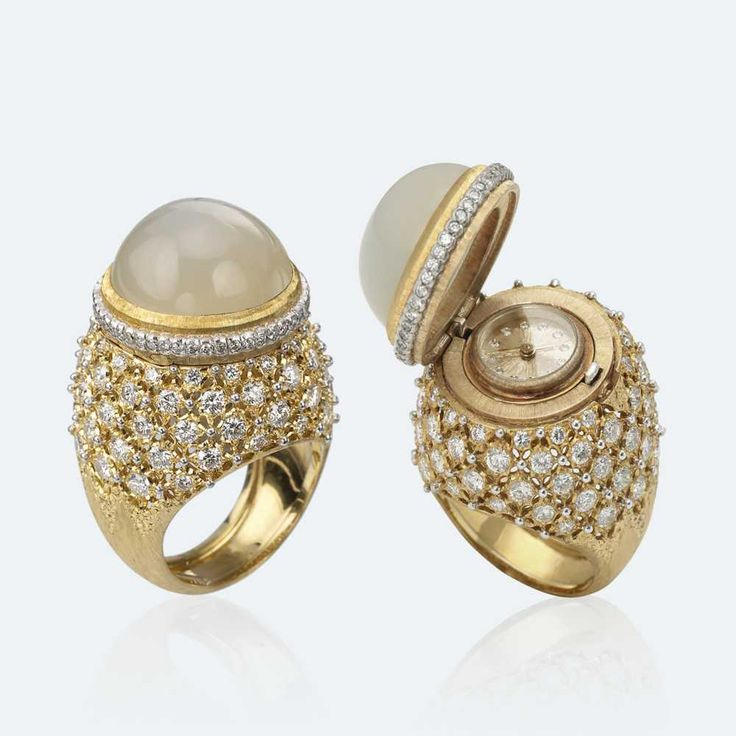 """The ring as a timekeeper: a hidden, secret time which is a surprise, amazing us for its discretion. Under the yellow gold bezel set with a moonstone, there is a small watch, radially """"rigato"""" engraved, with diamond numbers. When closed, the ring is embellished with brilliant-cut diamonds and an """"Ornato"""" and """"rigato"""" engraving, in pure Buccellati style. Http://www.facebook.com/diamonddreamfinejewelers http://www.twitter.com/diamond_dream_ http://www.instagram.com/diamonddreamjewelers"""