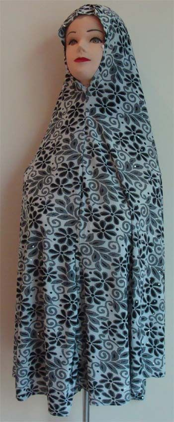 A long Hijab for the Modest Lady that falls upto the waist from the top. The hijab provides complete coverage upto the waist area. The hijab has beautiful floral patterns in it, making the garment very simple, yet graceful.