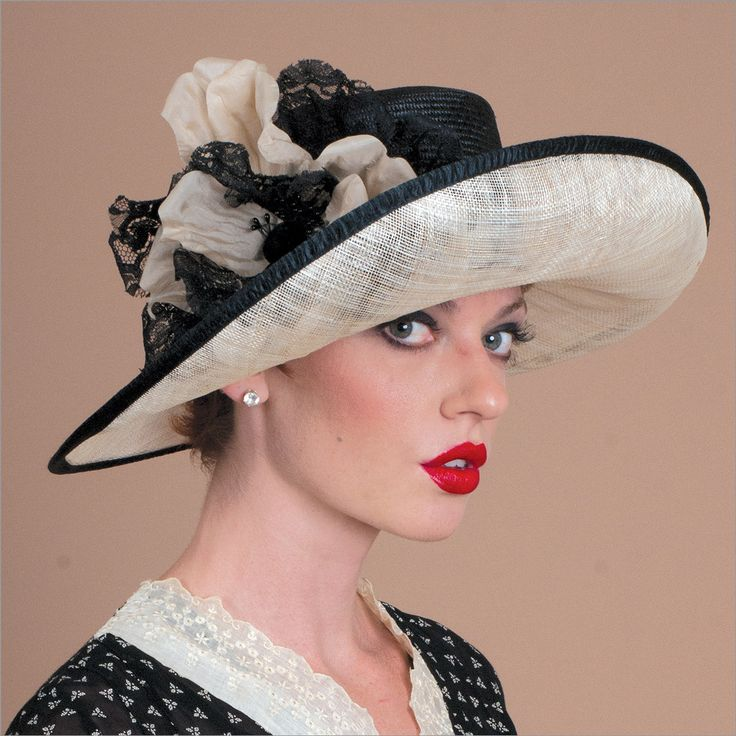 Hazel • Design by Louise Green • Fabric: Sisal crown and sinamay brim, fitted with their patented Silk Covered Elastic Headband • Colors: Black/natural • Size: Fits Most • Style: Large brim hats, great for derbies and garden parties • Handmade in USA