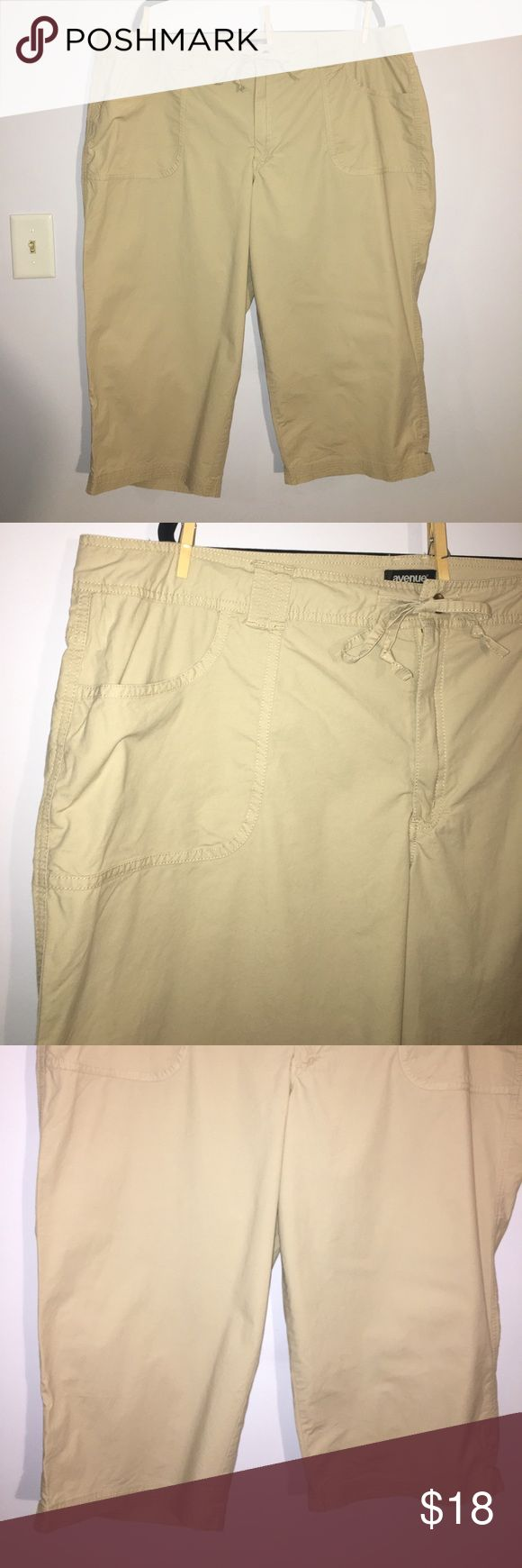 """Avenue Tan Khaki Capris size 22 Up for grabs is this pair of capris from Avenue. They are a size 22 with a 21.5"""" inseam and a 44"""" waist and 56"""" hips. These capris are a lightweight cotton-spandex blend in a tan color. They stretch well and have a zipper and button closure with a tie drawstring. These crops have been gently worn and are in wonderful condition. Avenue Pants Capris"""