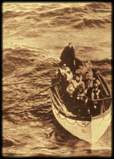 Survivors of the Titanic row to the Carpathia, 1912
