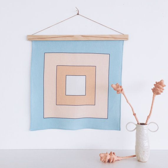 Hang all your art, prints, textiles and weaves with The Art Hanger. A simple and stylish design which is also an inexpensive solution to framing those unique art pieces that you never get around to displaying.  Cleverly cut The Art Hanger locks together the art piece with natural leather string. Designed perfectly to exhibit 50cm width Tea Towels, Paper/Photographic Prints, Woollen or Macrame Art Weaves and Textile Fabrics.  We designed this product especially for fellow Bondi designer f...