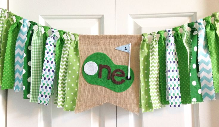 """One birthday banner ~Hole in """"one"""" Golf theme high chair banner ~party banner ~cake smash ~photo prop ~ 1st Birthday ~rag tie banner by backyardprims on Etsy https://www.etsy.com/listing/292655163/one-birthday-banner-hole-in-one-golf"""
