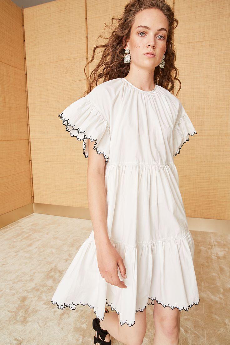 Scalloped embroidered cotton poplin midi dress. Contrast edge stitching, ruffle sleeve, tiered seams. #ullajohnson #cotton #poplin #scallopededges #whitedress