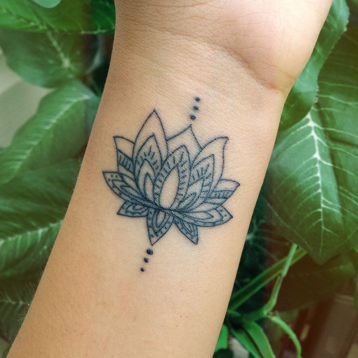 Lotus Flower — symbolizes strength, positivity & new beginnings.  Dots only