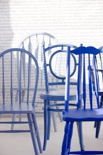Second hand chairs painted in different tones of the same colour!