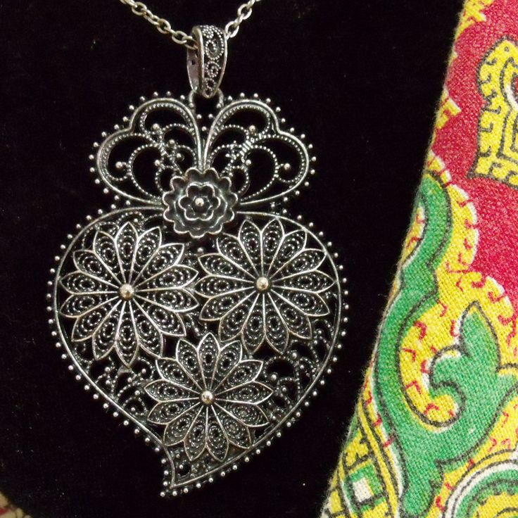 Portuguese folk antiqued silver Heart of Viana style pendant necklace. Inspired in the Portugal traditional filigree jewelry used by country women in the north of Portugal.$39.00 #vianaheart#madeinportugal#portugalheartofviana#vianaheartpendant#coraçaodeviana#portuguesefiligree#portuguesesilver#portugalfolkart#portuguesenecklace