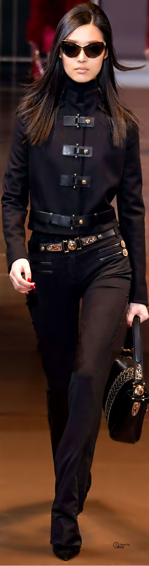 Versace Fall 2014. I adore the black biker jacket with leather and gold-dome buckles, and the jeans are absolutely kick-ass. I wouldn't mind wearing something this awesome during the zombie apocalypse!
