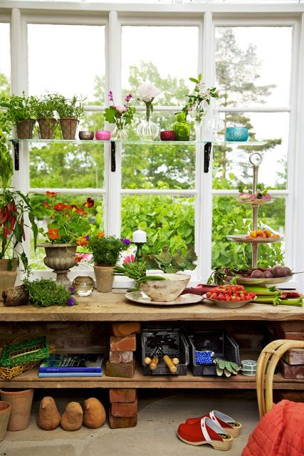 Many work surfaces, old tables, basin sinks, timed auto-drip watering system, storage for gardening tools, etc...
