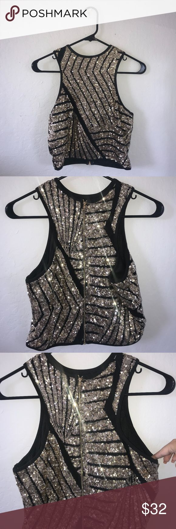 Gold & Black Crop Top Gold & Black sparkly crop top from Windsor. Perfect for upcoming holiday festivities. The black detailing between the sparkles has a sheer look to it but it is not actually sheer in any way.  Zipper on the back.  I'm 5'3 and it reaches my ribs. Could probably fit someone who usually wears a size M. Brand New with tags. Windsor Tops Crop Tops