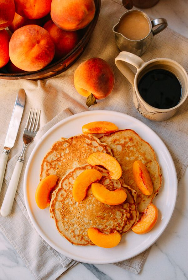 Fresh, sweet, and fragrant peaches are one of my favorite fruits to eat, and they're pretty much only good in the summertime. My latest seasonal peach recipe? Peach pancakes. I'll explain. When peach season strikes, Judy and I go a little crazy. Why buy a tiny basket of peaches when you could buy a whole …