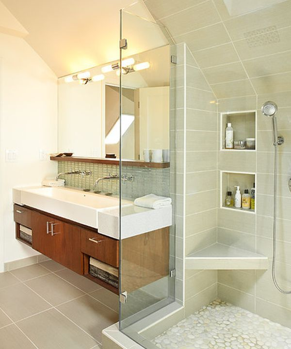 Classy floating sink cabinet set in a contemporary bathroom clad in glass. Great universal design too!