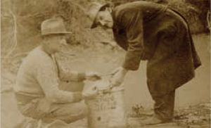 Releasing fish into the Plenty River between the wars