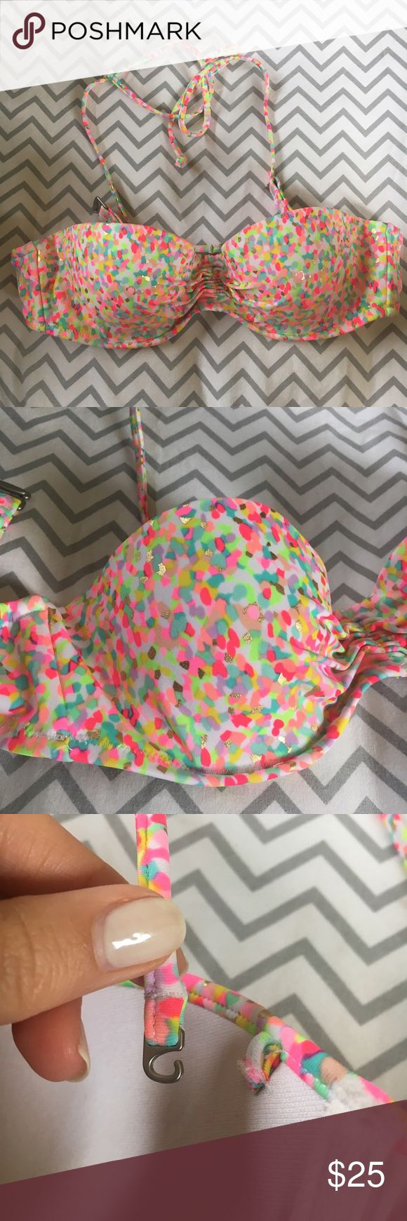 VICTORIA SECRET swim top Strapless with optional halter strap. Worn twice. Size 32b. A little padding. Victoria's Secret Swim Bikinis