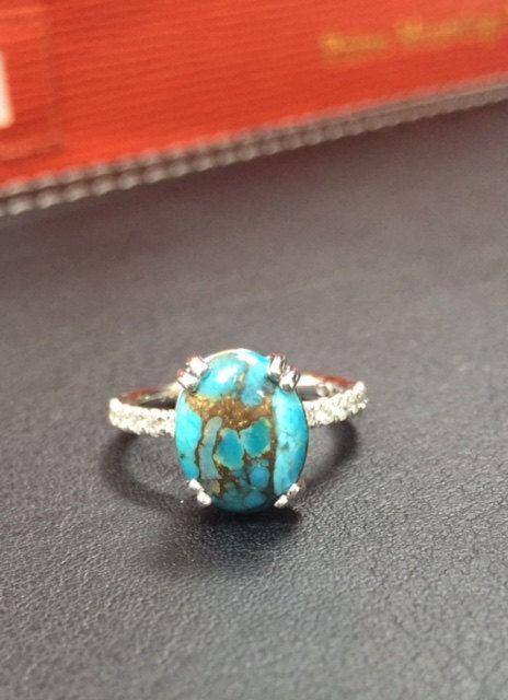 Gorgeous and Very Unique Copper Turquoise Diamond Ring available in different variations. This beautiful ring is made of 14K solid white, yellow or rose gold weighing approximately 2.90 grams with 12 round diamonds around the ring (0.28 ct) and a copper turquoise stone in the center (3.50 ct). Turquoise is considered one of the most ancient gemstones, yet it will forever remain popular in the world of jewelry. Copper turquoise generally varies in the shades of blue and green. Product…