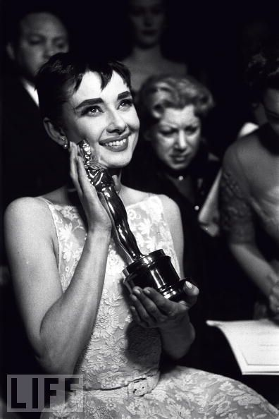 …Audrey Hepburn After  After delivering a brief but touchingly sincere acceptance speech, the ecstatic young actress cradles her prize. Not counting the Jean Hersholt award for her humanitarian efforts, this would be the only Oscar she'd ever win.