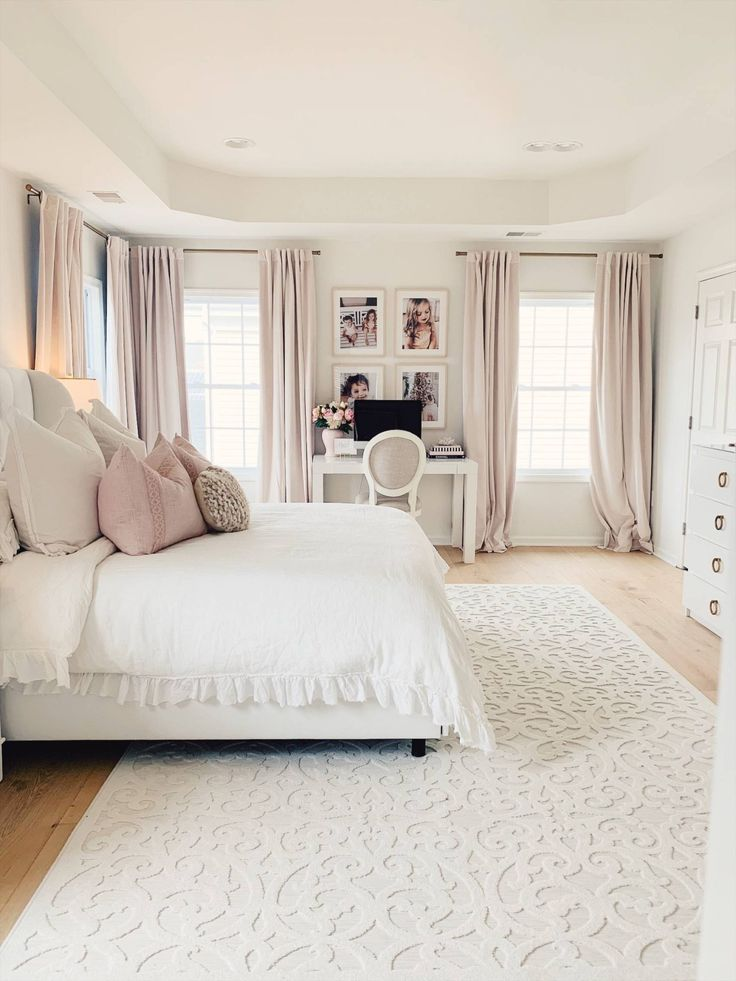 Romantic master bedroom with white tufted bed, linen duvet, soft curtains master bedroom makeover, white tufted bed, white and gold lamps, white with brass nightstand, white Orian rug