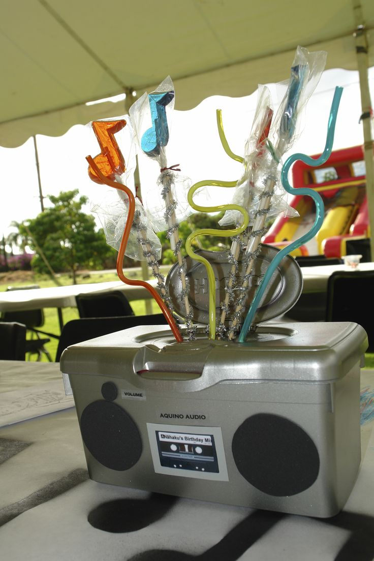 Centerpieces from my son's music-themed party.  Baby wipes dispenser sprayed with silver spray paint.