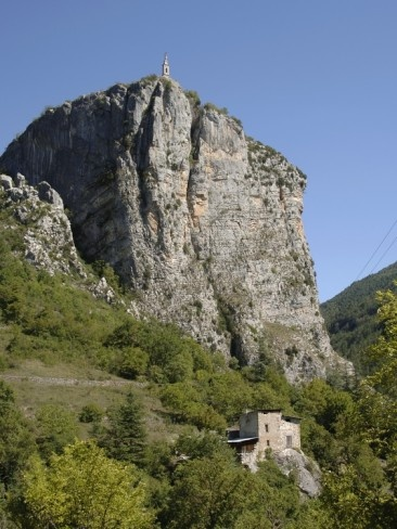 Rock of Castellane (with chapel on top) towering over home in France. There is a 20 minute hike up to this small chapel I took with my husband and kids.