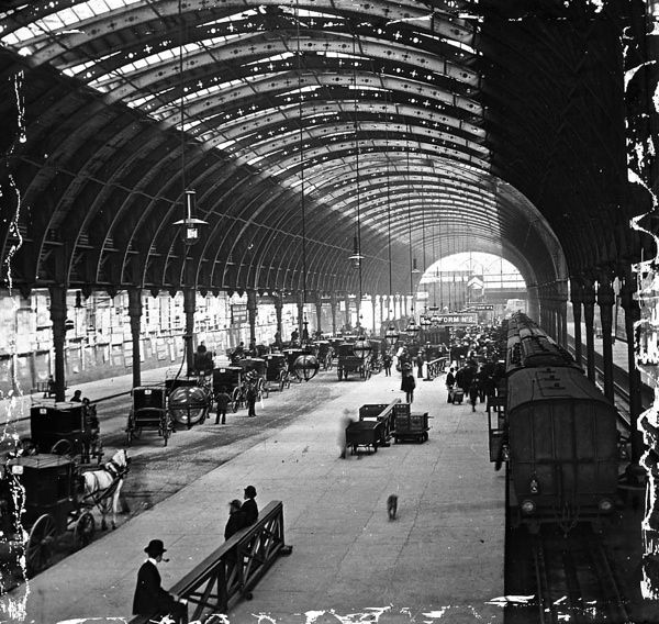 A fascinating late Victorian view of Brunel's London Paddington station before it was extended on the east side with a fourth roof span.  The train is in platform 6 and the view is towards the buffer stops.