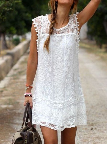 Look your best by donning this white lace shift dress. It's designed with a crew neckline and a full white lining, it also comes with pom-pom trimming for a whimsy look. | Lookbook Store Dress