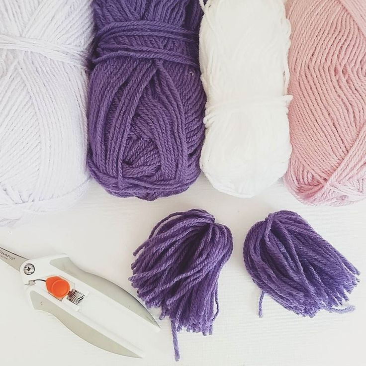 Restocking yarn tassel garlands. This time it's purple lavender pink and white wool.