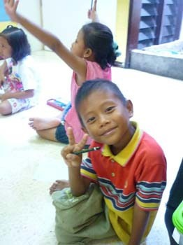 A student perhaps a bit distracted by the opportunity to pose. Teaching practice with TEFL Indonesia.