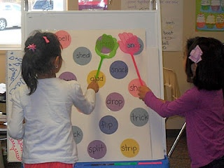 """Slap the Word"" game.... Play with sight words or spelling words for the week...easy to make.  Die cut circles and glue to poster board. Could laminate first then write on it with wet erase markers so the words can change to match what is being taught with some for review too."