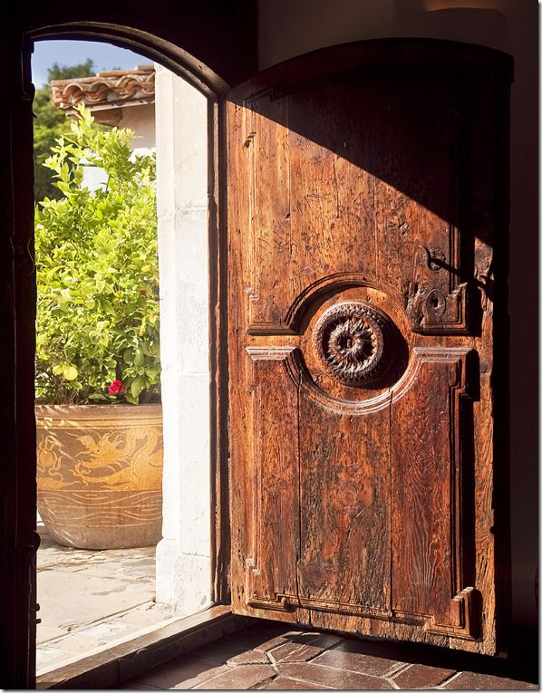 love this kind of door: heavy, bold, and with lots of character