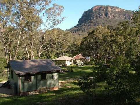 Cabins with Newnes Hotel in  the background