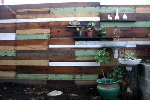 before & after: salvaged backyard renovation (screws & nails; two 2 x 4s; three bags of cement for mortar and setting fence posts; two bags of decorative beach stones; water pump from Goodwill; tchotchkes from Goodwill; lemon tree and moss) #fence #junk #up-cycle http://www.designsponge.com/2012/03/before-after-salvaged-backyar-renovation.html