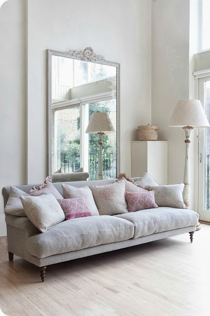 large mirrors comfy sofa makes me want to curl up with a cup of coffee and an interior magazine!