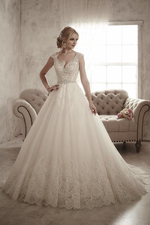 Balletts Bridal - 22772 - Wedding Gown by Jacquelin Bridals Canada - The heavily beaded bodice of this gown has an illusion tank neckline and capped sleeves. The tulle skirt has large lace appliqué detailing.