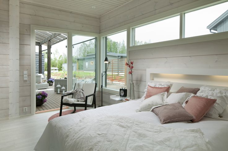 Master bedroom opens to the terrace. Honka log homes.