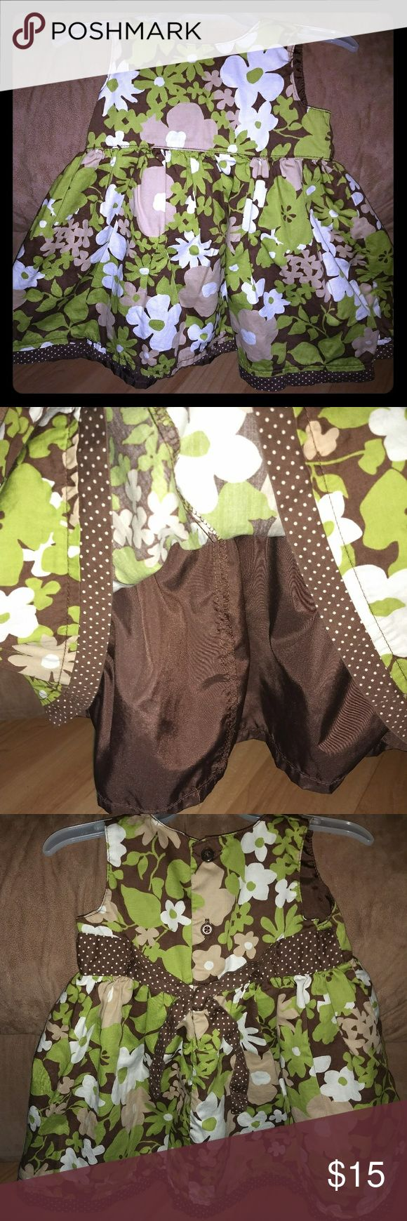 Little girl's dress with tie in back. Little girl's dress with tie in back. It does have brown liner as shown in picture. Summer/Spring. Great condition and from smoke free home. Dresses