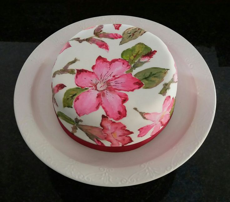 Bright pink Impala lilies indigenous to the Kruger National Park in SA, hand-painted on dark fruit cake soaked in brandy. Yum!